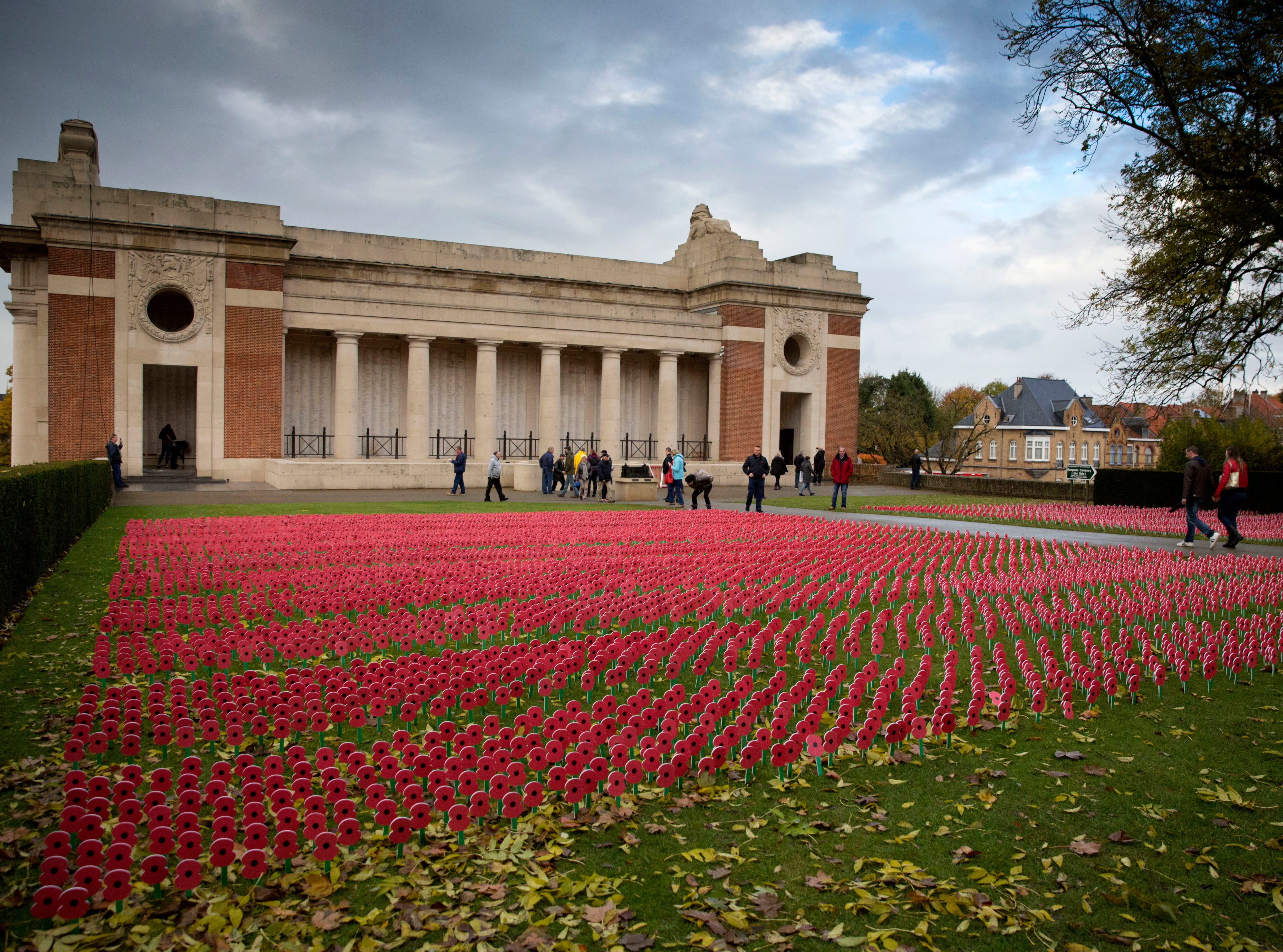 Paper poppies fill a field outside the Menin Gate in Ypres, Belgium, Saturday, Nov. 10, 2018. The walls of the Menin Gate bear the names of more than 54,000 World War I soldiers who died before Aug. 16, 1917 and have no known grave.
