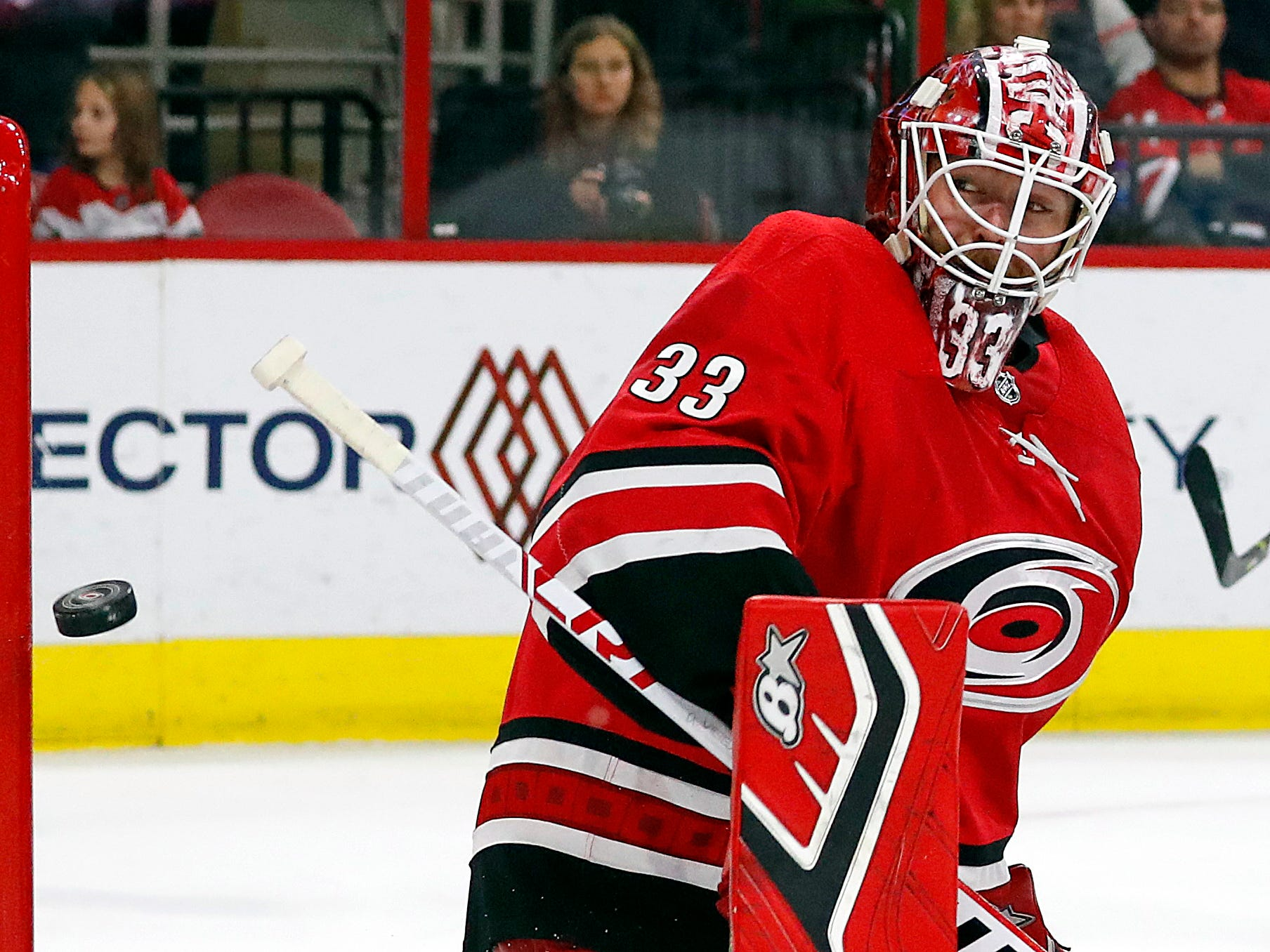 Carolina Hurricanes goaltender Scott Darling eyes the puck as it hits the post during the second period.
