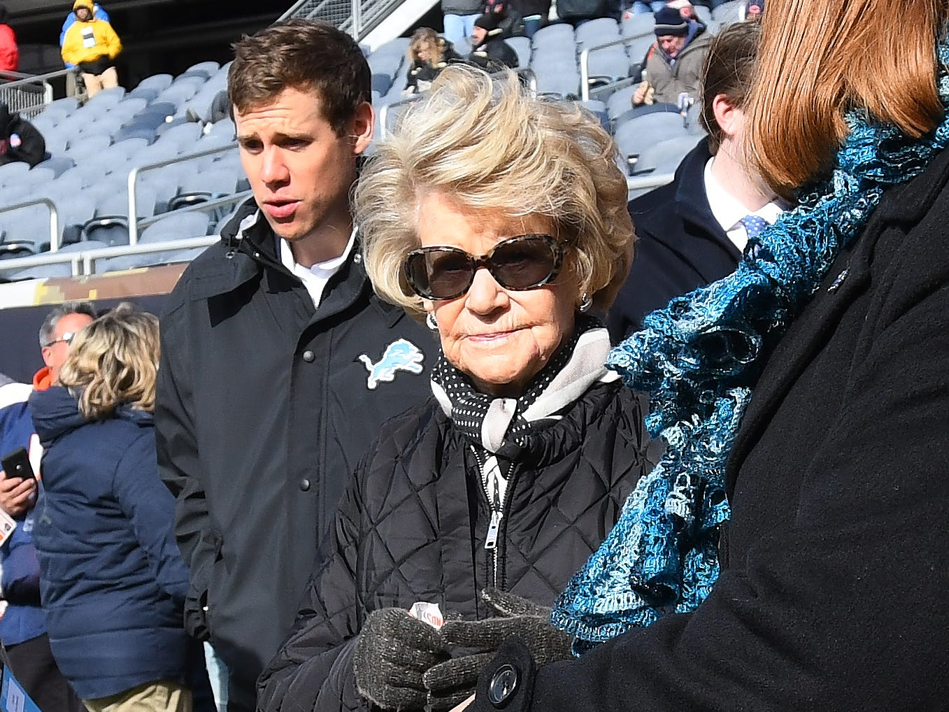 Lions owner Martha Ford comes out onto the frosty field at Soldier Field before Detroit takes on the Chicago Bears.