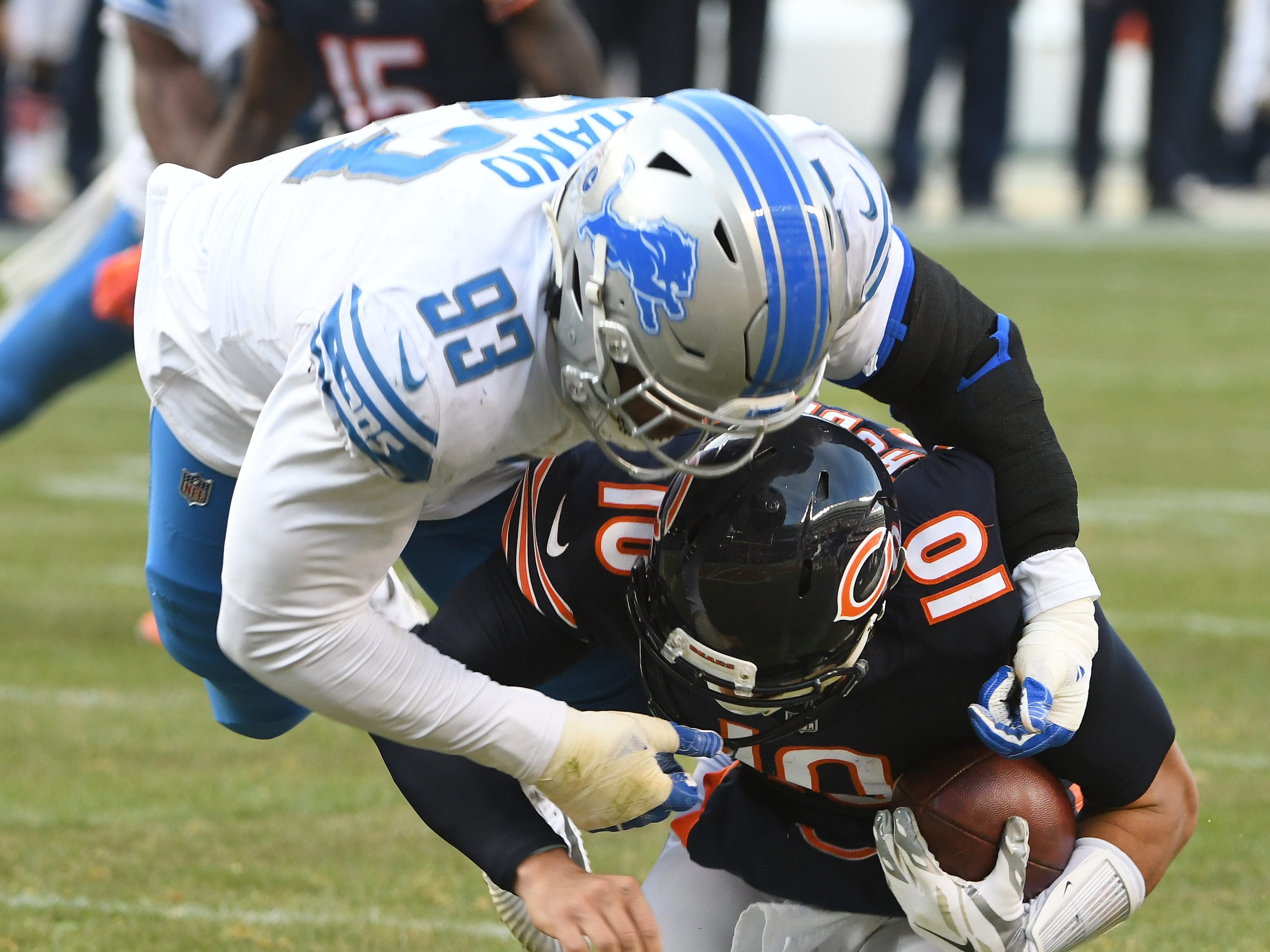 Lions' Da'Shawn Hand sacks Bears quarterback Mitchell Trubisky just short of the end zone, placing the ball at the one yard line after an officials review in the fourth quarter.
