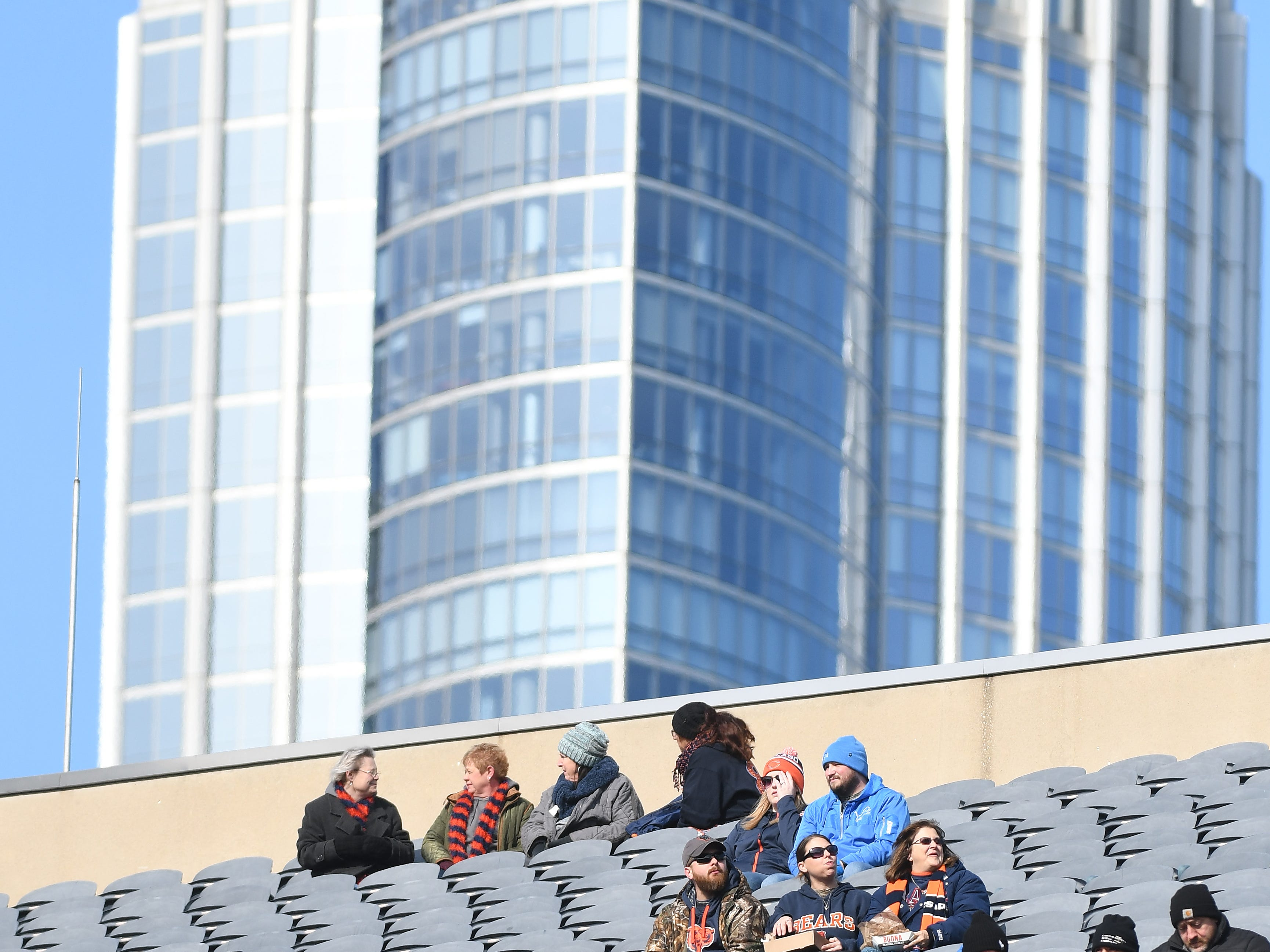 Bears and Lions fans cohabitate near the top level at Soldier Field before Detroit takes on the Chicago Bears at Soldier Field.