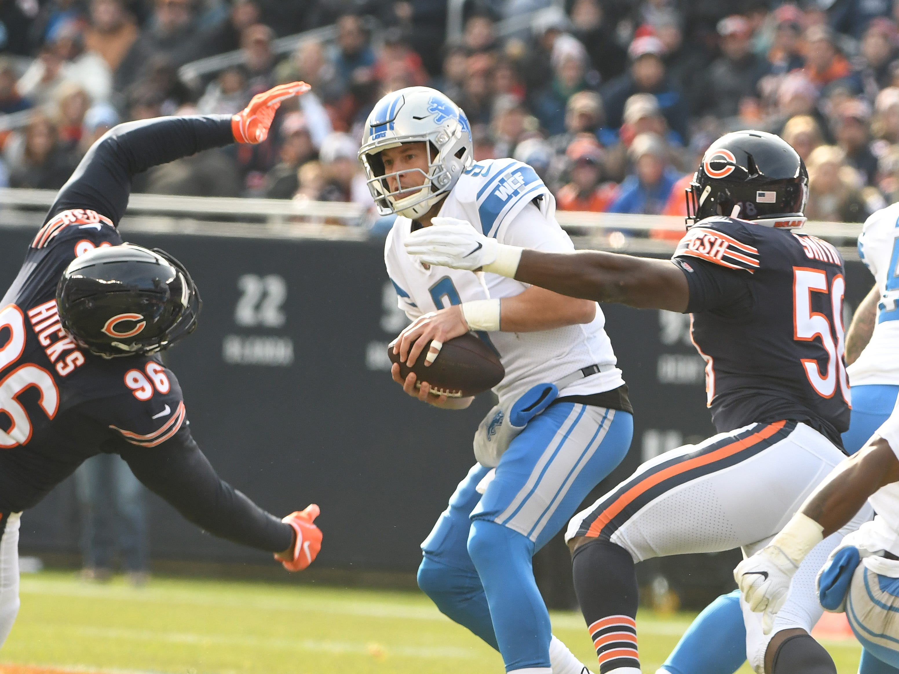 The hits are coming as Lions quarterback Matthew Stafford braces for a sack by Bears' Akiem Hicks and Roquan Smith in the fist quarter.