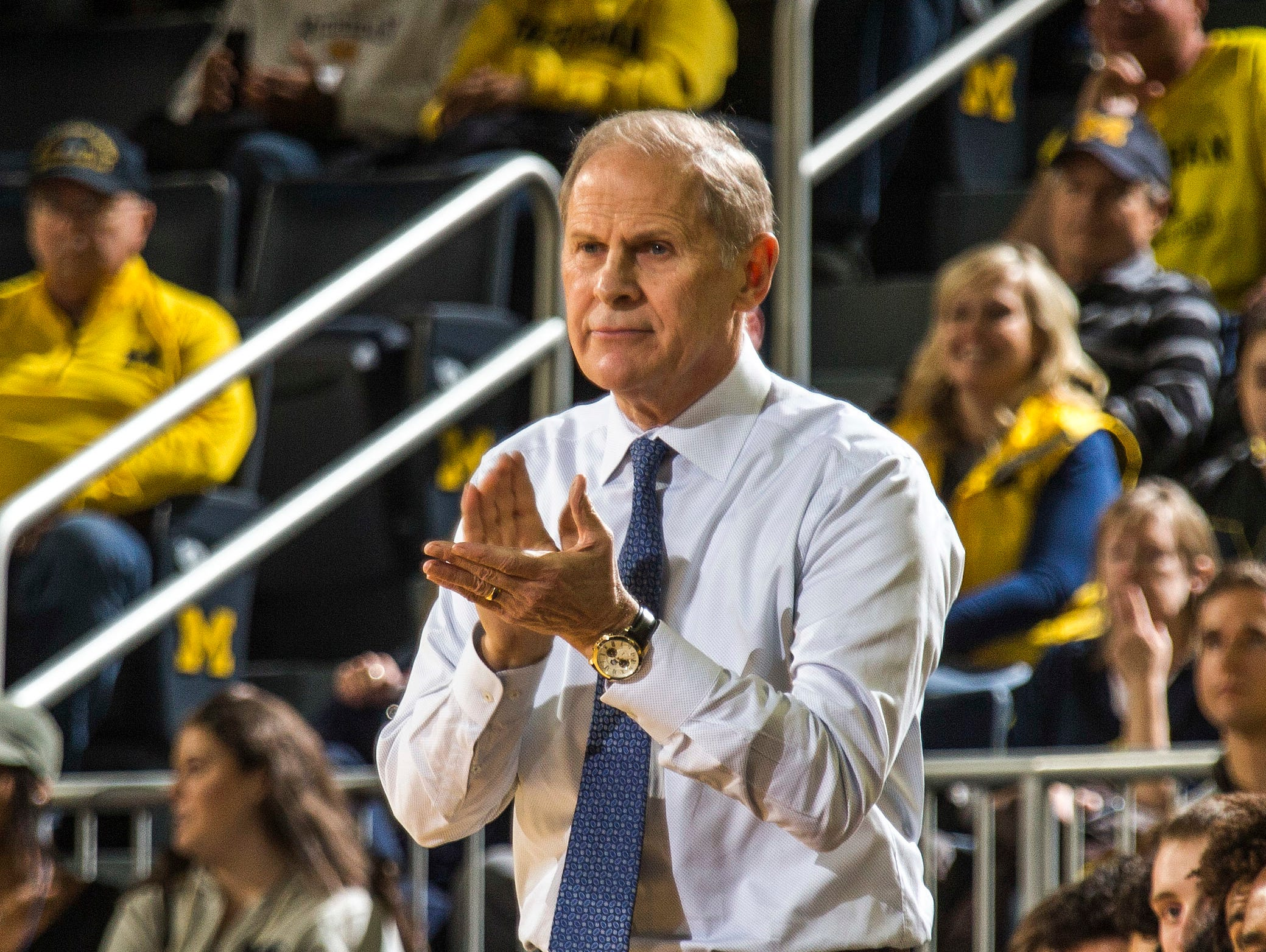 Michigan head coach John Beilein claps for his players from the bench in the first half of an NCAA college basketball game against Holy Cross at Crisler Center in Ann Arbor, Mich., Saturday, Nov. 10, 2018. Michigan won 56-37. (AP Photo/Tony Ding)