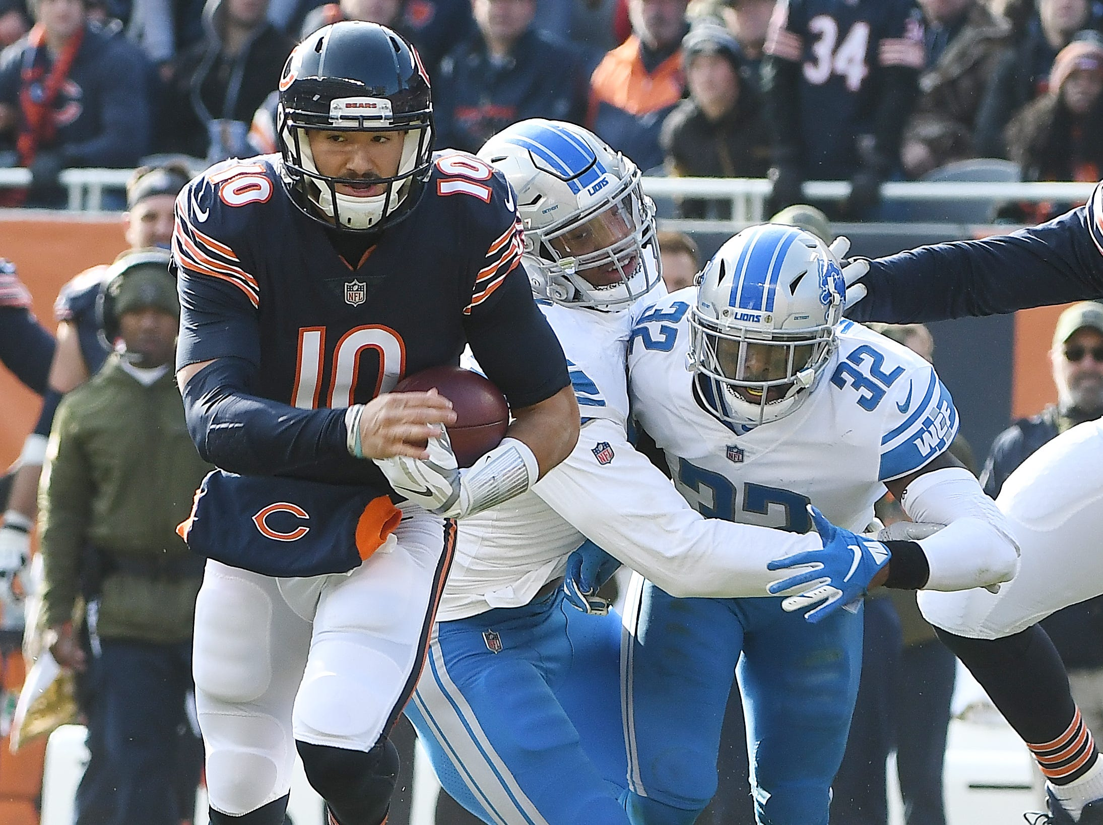 Lions' Romeo Okwara and Tavon Wilson collide as Bears quarterback Mitchell Trubviwsky evades the Lions defense for a long gain in the second quarter.
