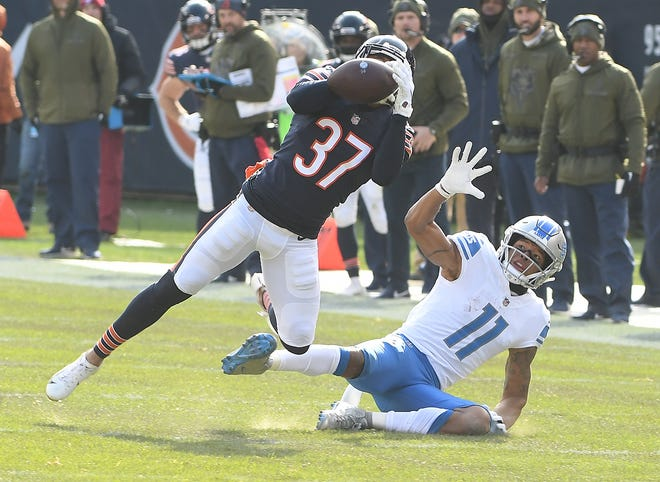 The Bears' Bryce Callahan picks off a Matthew Stafford pass intended for Lions wide receiver Marvin Jones Jr. in the second quarter.