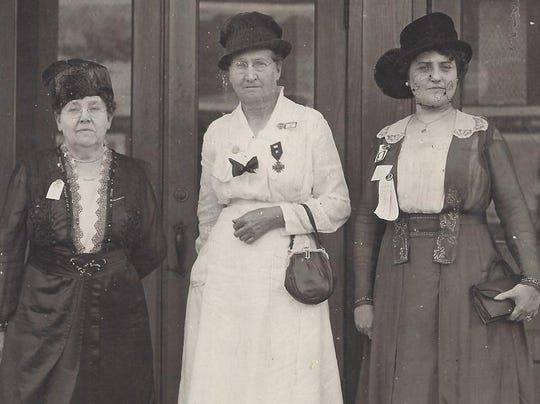 The officers presiding over the first national War Mothers convention. From left, Gertrude Schulz, Alice Gresham Dodd, Boaz Crawford