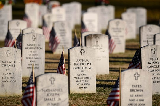 Veterans graves at Oak Hill Cemetery Saturday, November 10, 2018.