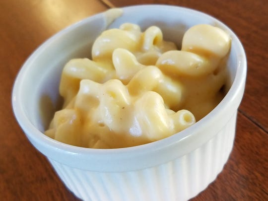 Three cheese macaroni and cheese with cavatappi noodles, Fontina, Cheddar and Parmesan cheeses made by Chef Adam Edwards.