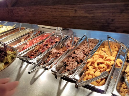 Moonlite Bar-B-Q Inn in Owensboro is known for a large buffet that gives patrons a chance to sample many meats and sides.