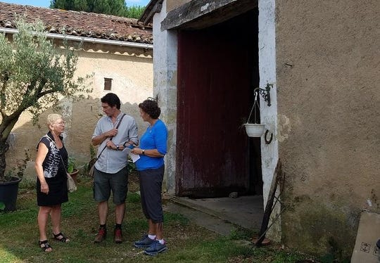 Nancy Hasting, right, with Christianne Taildeman and Ludovic Chasseigne at one of the barns outside Mussican that housed American soldiers in WW I.