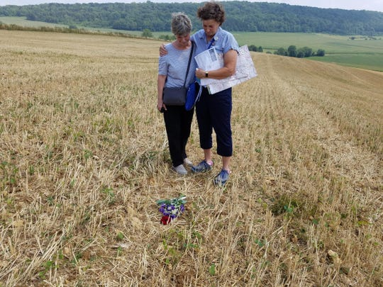 Ann Stevenson (left) and Nancy Hasting reflect for a moment after placing a bouquet of flowers at the spot where their great uncle, Chester Schulz, was killed on Nov. 7,1918, in the Meuse-Argonne offensive.