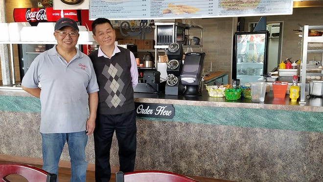 Manager Jimmy Yeh, left, and owner Charlie Cao at Charlie's Cafe on Diamond Avenue.