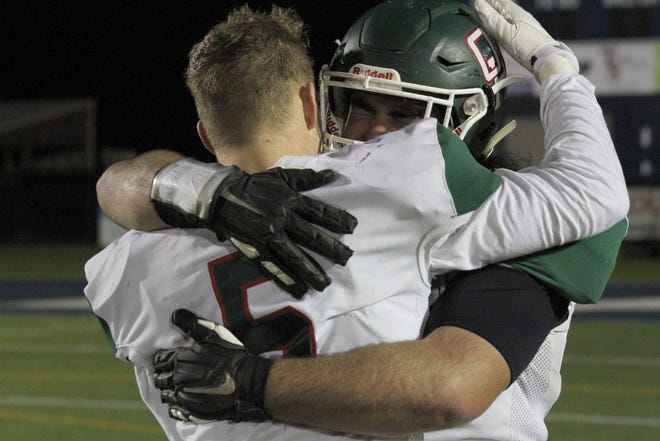 Oak Harbor's Clay Schulte, front, and Cole Roob embrace after the Rockets' 14-0 loss to Liberty Center in the regional semifinal at Lake.