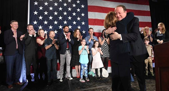 Colorado Governor-elect Jared Polis hugs his Lt. Gov.-elect Dianne Primavera during his victory speech at the watch party for Colorado Democrats at the Westin Hotel in downtown Denver, Tuesday, Nov. 6, 2018