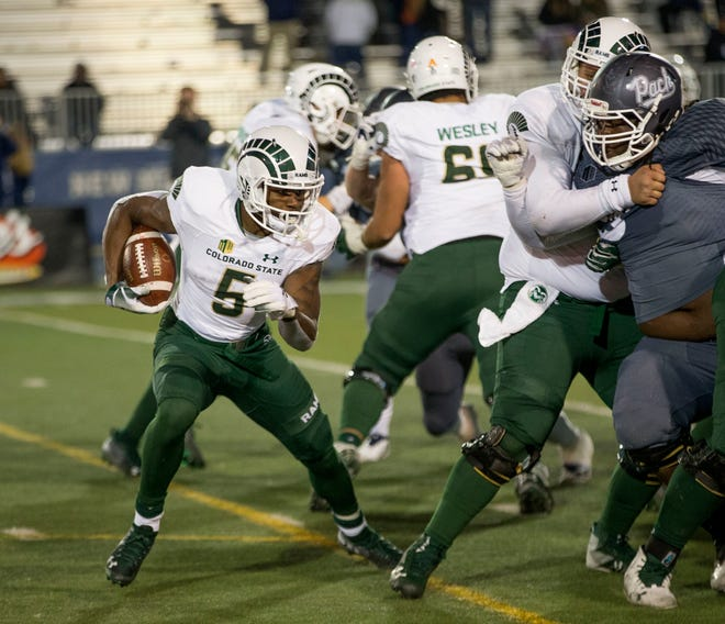 CSU's Marvin Kinsey looks for an opening in the Nevada defense during a 49-10 loss to the Wolf Pack on Saturday night in Reno, Nev. Kinsey and the Rams will play their final home game of the season Saturday against Utah State.