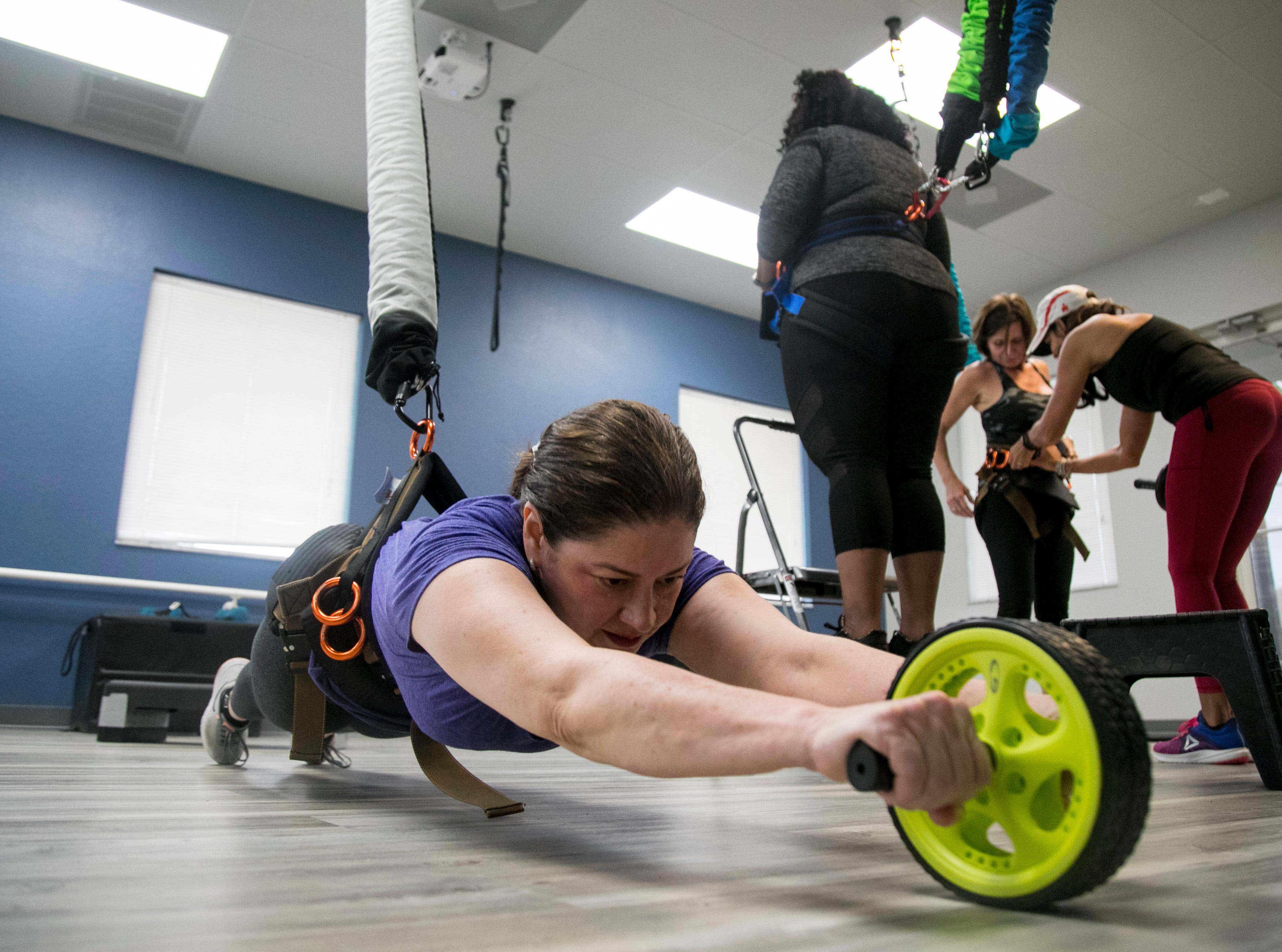Ana Roman tries out the Astro-Durance bungee workout at P2 Personal Training in Cape Coral on Wednesday, November 7, 2018.