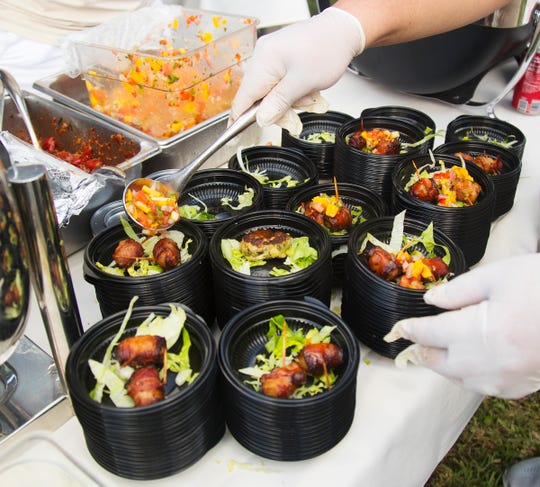 Appetizers from the Sandollar Restaurant are among the foods available at the Taste of the Islands event on Sunday at Sanibel Community Park. The annual gathering features food from 13 island eateries and benefits The Clinic for the Rehabilitation of Wildlife (CROW).
