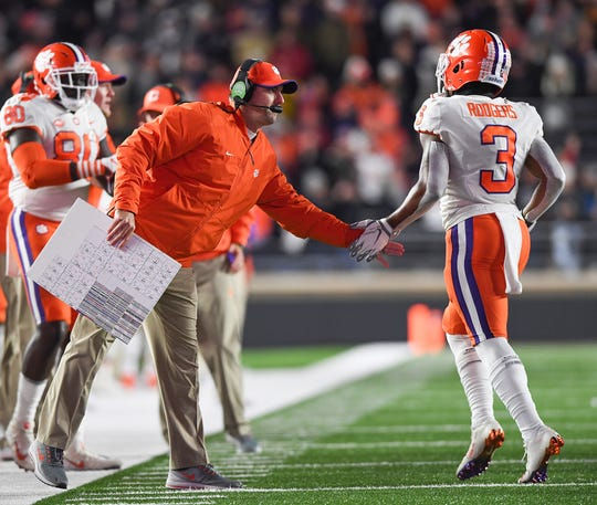 Clemson co-offensive coordinator Jeff Scott and wide receiver Amari Rodgers (3) during the 1st quarter at Boston College's Alumni Stadium in Chestnut Hill, MA. Saturday, November 10, 2018.