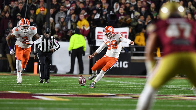 Clemson place kicker B.T. Potter (29) kicks off against Boston College during the 1st quarter at Boston College's Alumni Stadium in Chestnut Hill, MA. Saturday, November 10, 2018.
