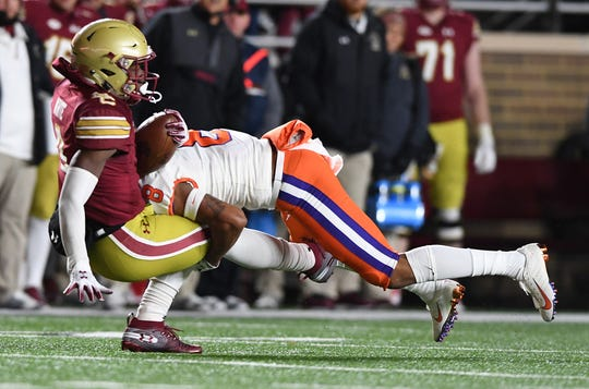 Clemson defensive back A.J. Terrell (8) hits Boston College wide receiver Kobay White (9) during the 4th quarter at Boston College's Alumni Stadium in Chestnut Hill, MA. Saturday, November 10, 2018.