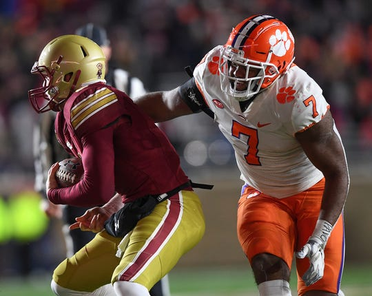 Clemson defensive lineman Austin Bryant (7) closes in on Boston College quarterback EJ Perry (4) during the 4th quarter at Boston College's Alumni Stadium in Chestnut Hill, MA. Saturday, November 10, 2018.