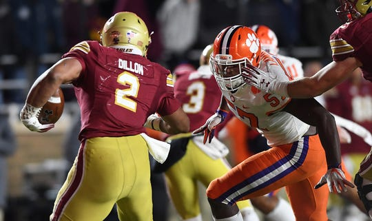 Clemson linebacker Tre Lamar (57) closes in on Boston College running back AJ Dillon (2) during the 4th quarter at Boston College's Alumni Stadium in Chestnut Hill, MA. Saturday, November 10, 2018.
