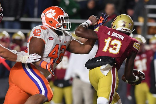 Clemson defensive lineman Christian Wilkins (42) tries to bring down Boston College quarterback Anthony Brown (13) during the 1st quarter at Boston College's Alumni Stadium in Chestnut Hill, MA. Saturday, November 10, 2018. Brown was injured on the play and left the game.