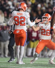 Clemson holder Will Swinney (22) congratulates place kicker Greg Huegel (92) after Huegel kicked a field goal against Boston College during the 2nd quarter at Boston College's Alumni Stadium in Chestnut Hill, MA. Saturday, November 10, 2018.