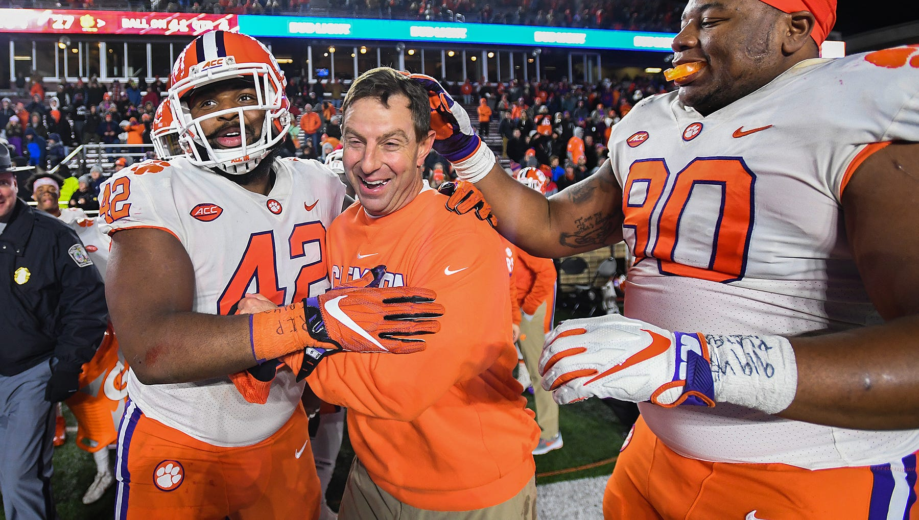 Clemson head coach Dabo Swinney celebrates the Tiger 27-7 win over Boston College with defensive lineman Christian Wilkins (42), left, and defensive lineman Dexter Lawrence (90) at Boston College's Alumni Stadium in Chestnut Hill, MA. Saturday, November 10, 2018.
