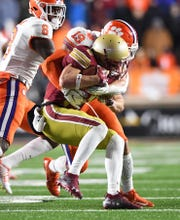 Clemson defensive back Tanner Muse (19) brings down Boston College quarterback EJ Perry (4) during the 4th quarter at Boston College's Alumni Stadium in Chestnut Hill, MA. Saturday, November 10, 2018.