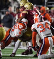 Clemson linebacker Tre Lamar (57) brings down Boston College running back AJ Dillon (2) during the 1st quarter at Boston College's Alumni Stadium in Chestnut Hill, MA. Saturday, November 10, 2018.