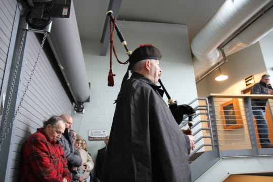 Jesse Callender plays the bagpipes at the Veterans Day ceremony in Great Falls Sunday.