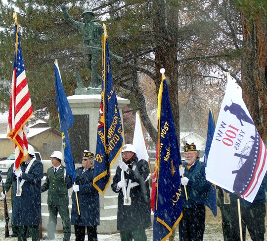 Fort Benton veterans and others in the community gather at the Doughboy statue to commemorate 100 years since the end of World War I on Sunday.