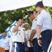 Sgt. Jesse Manglona, left, of the Guam Army National Guard, is recognized as one of the Active Duty/Civil Servants Veterans of the Year during a Veterans Day ceremony at the Gov. Joseph Flores Memorial Park on Nov. 11, 2018.