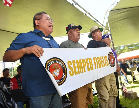 Marine Corps veterans sing the Marines' Hymn during a Veterans Day ceremony at the Gov. Joseph Flores Memorial Park on Nov. 11, 2018.