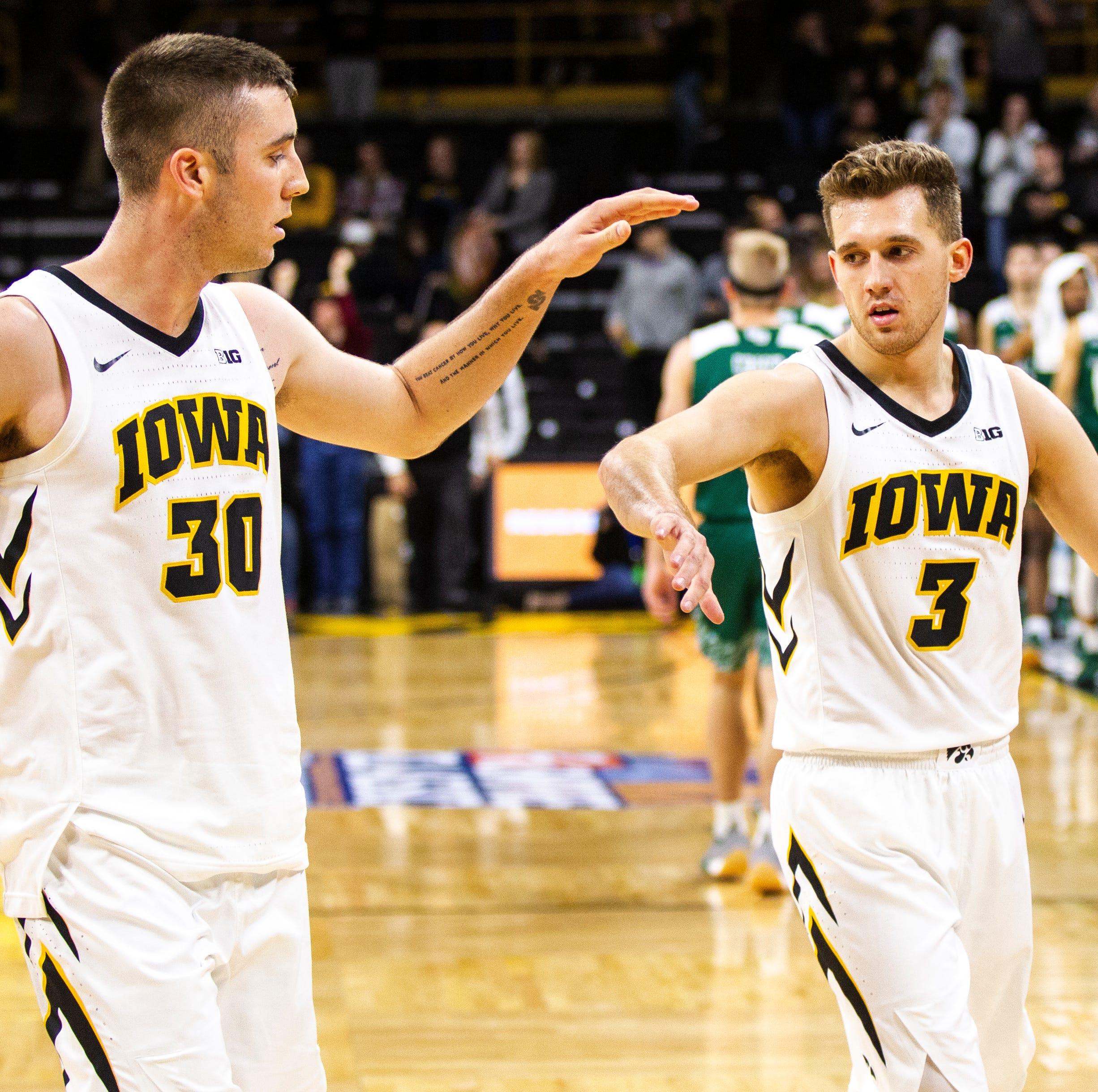 Iowa guard Connor McCaffery (30) high-fives Iowa...