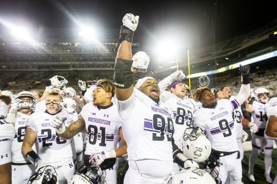 Northwestern's Jordan Thompson (99) celebrates with teammates after a Big Ten Conference football game on Saturday, Nov. 10, 2018, at Kinnick Stadium in Iowa City.
