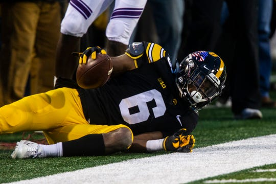Iowa wide receiver Ihmir Smith-Marsette (6) looks to an official after catching a pass during a Big Ten Conference football game on Saturday, Nov. 10, 2018, at Kinnick Stadium in Iowa City.