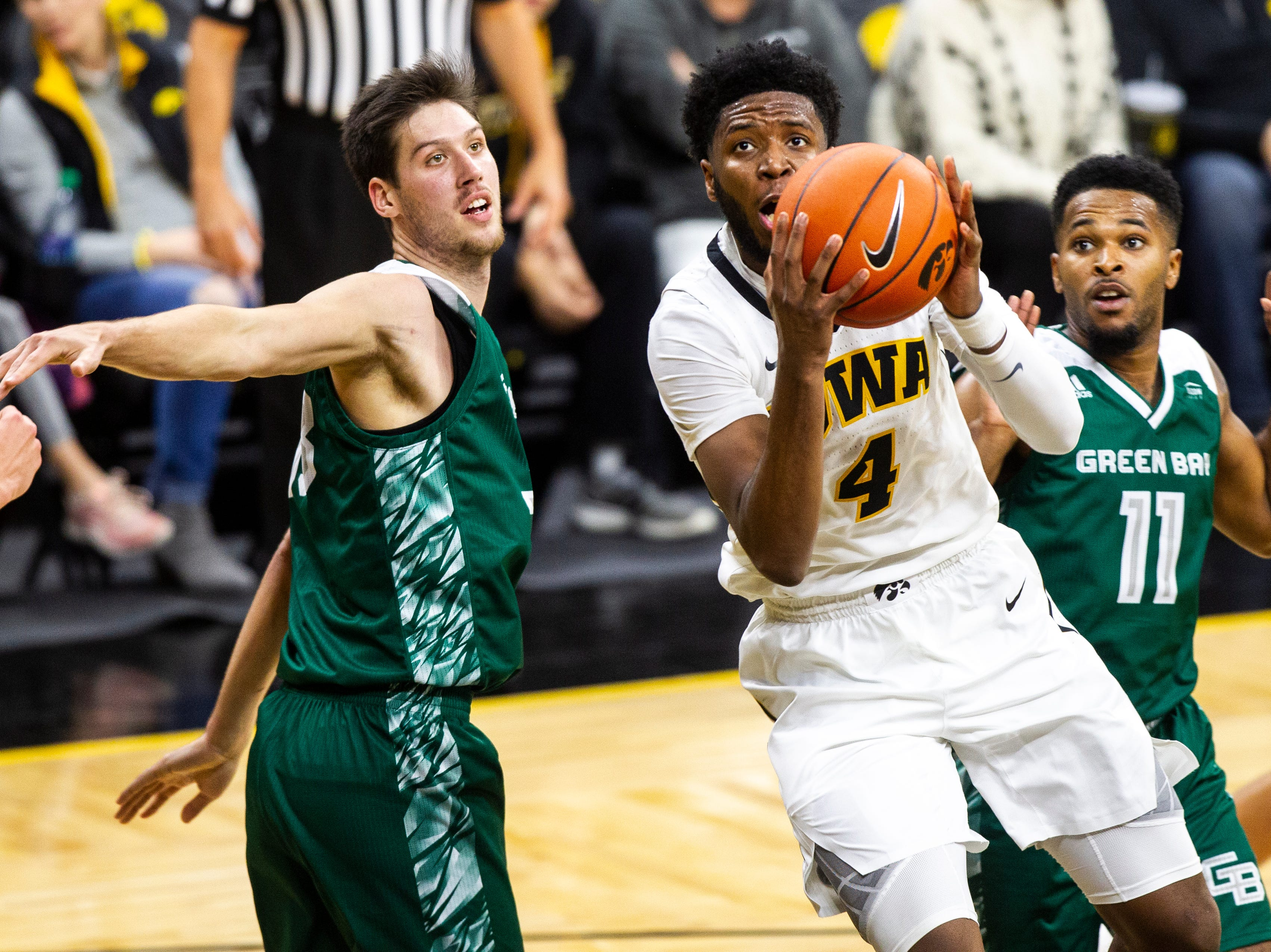 Iowa guard Isaiah Moss (4) attempts a layup during an NCAA men's basketball game in the 2K Empire Classic on Sunday, Nov. 11, 2018, at Carver-Hawkeye Arena in Iowa City.