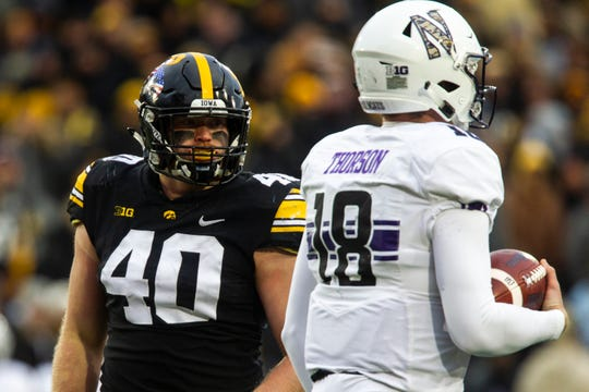Iowa defensive end Parker Hesse (40) looks at Northwestern's Clayton Thorson (18) after taking a knee during a Big Ten Conference football game on Saturday, Nov. 10, 2018, at Kinnick Stadium in Iowa City.