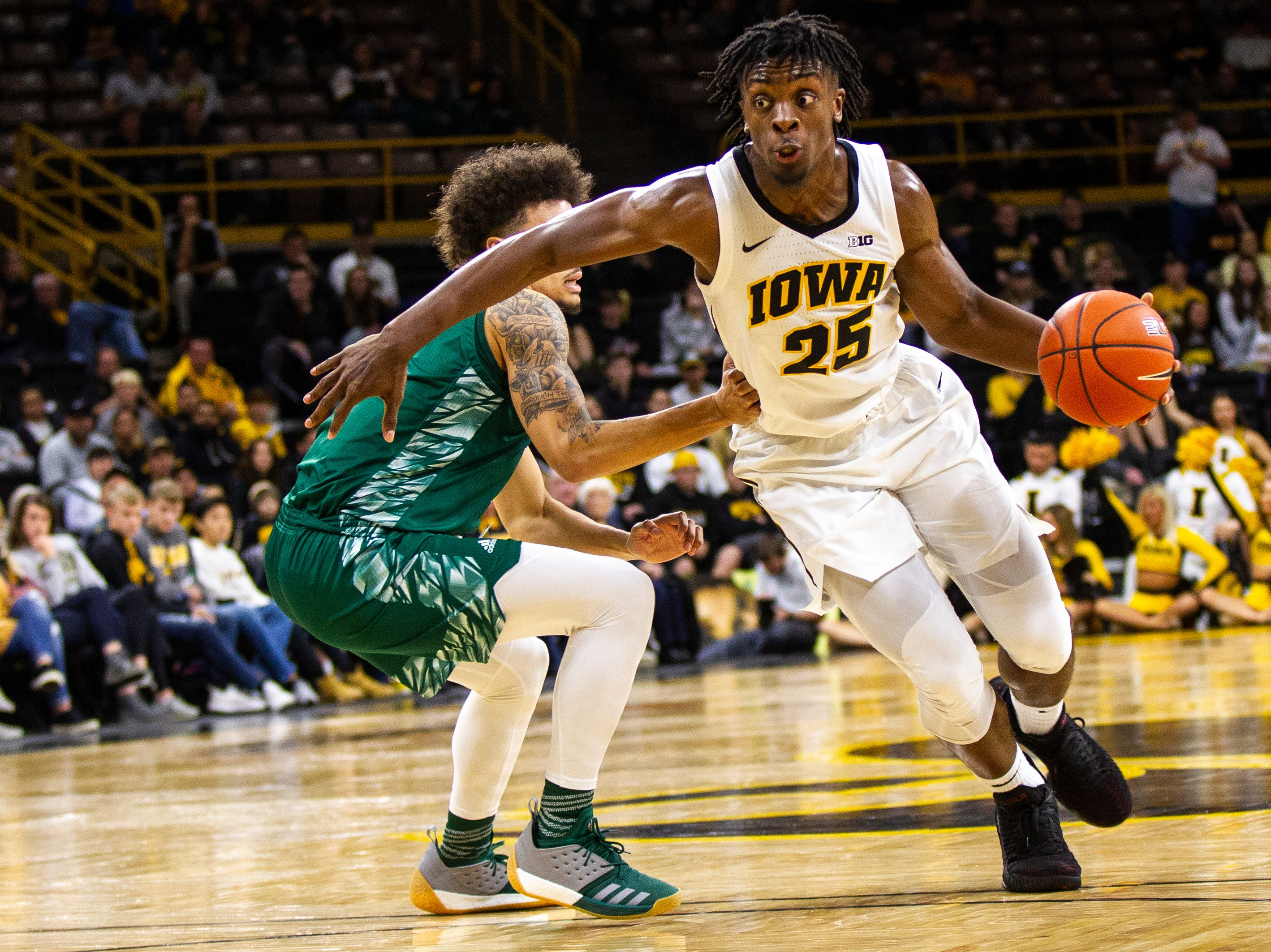 Iowa forward Tyler Cook (25) drives to the hoop during an NCAA men's basketball game in the 2K Empire Classic on Sunday, Nov. 11, 2018, at Carver-Hawkeye Arena in Iowa City.