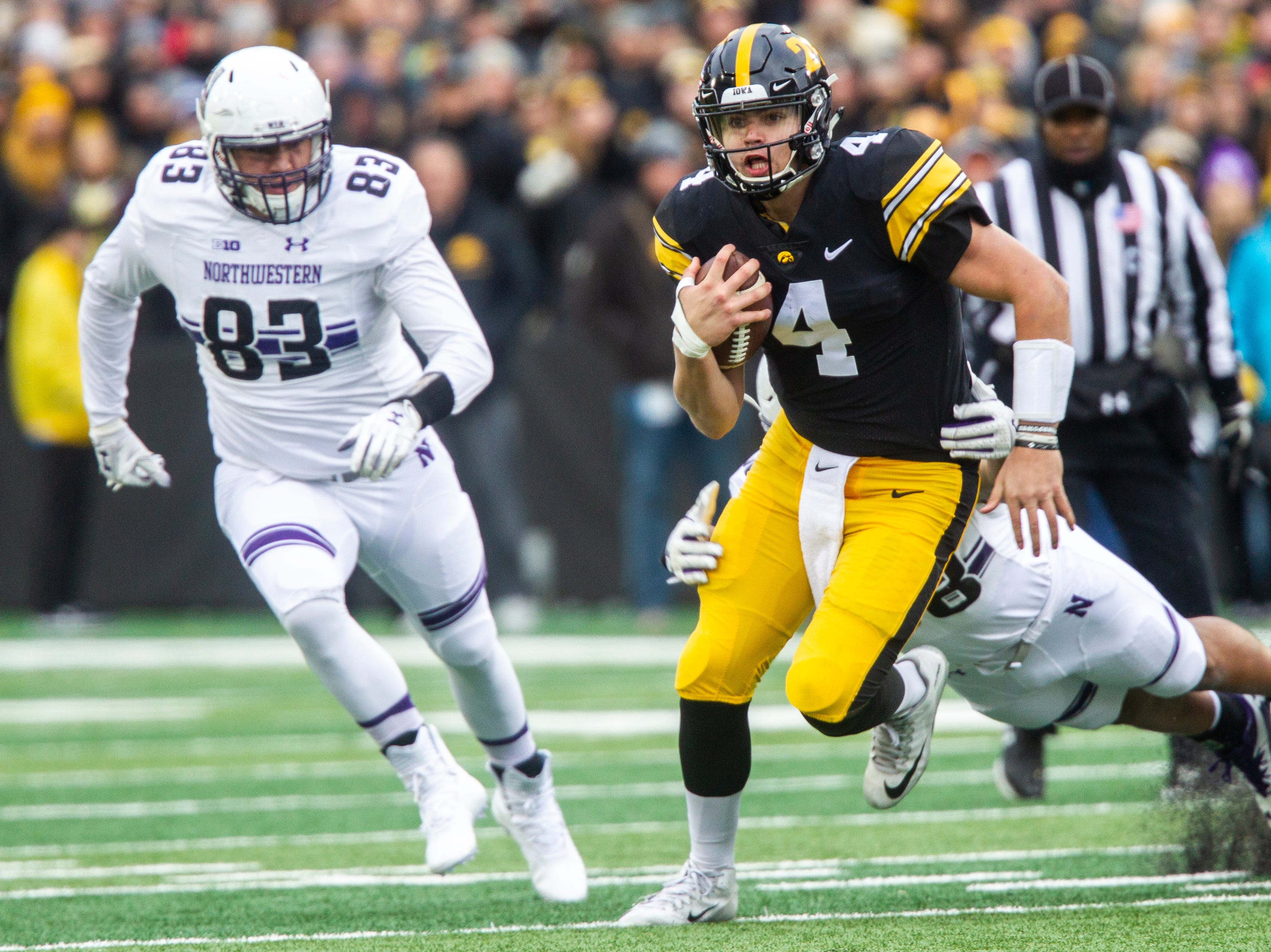 Iowa quarterback Nate Stanley (4) rushes during a Big Ten Conference football game on Saturday, Nov. 10, 2018, at Kinnick Stadium in Iowa City.