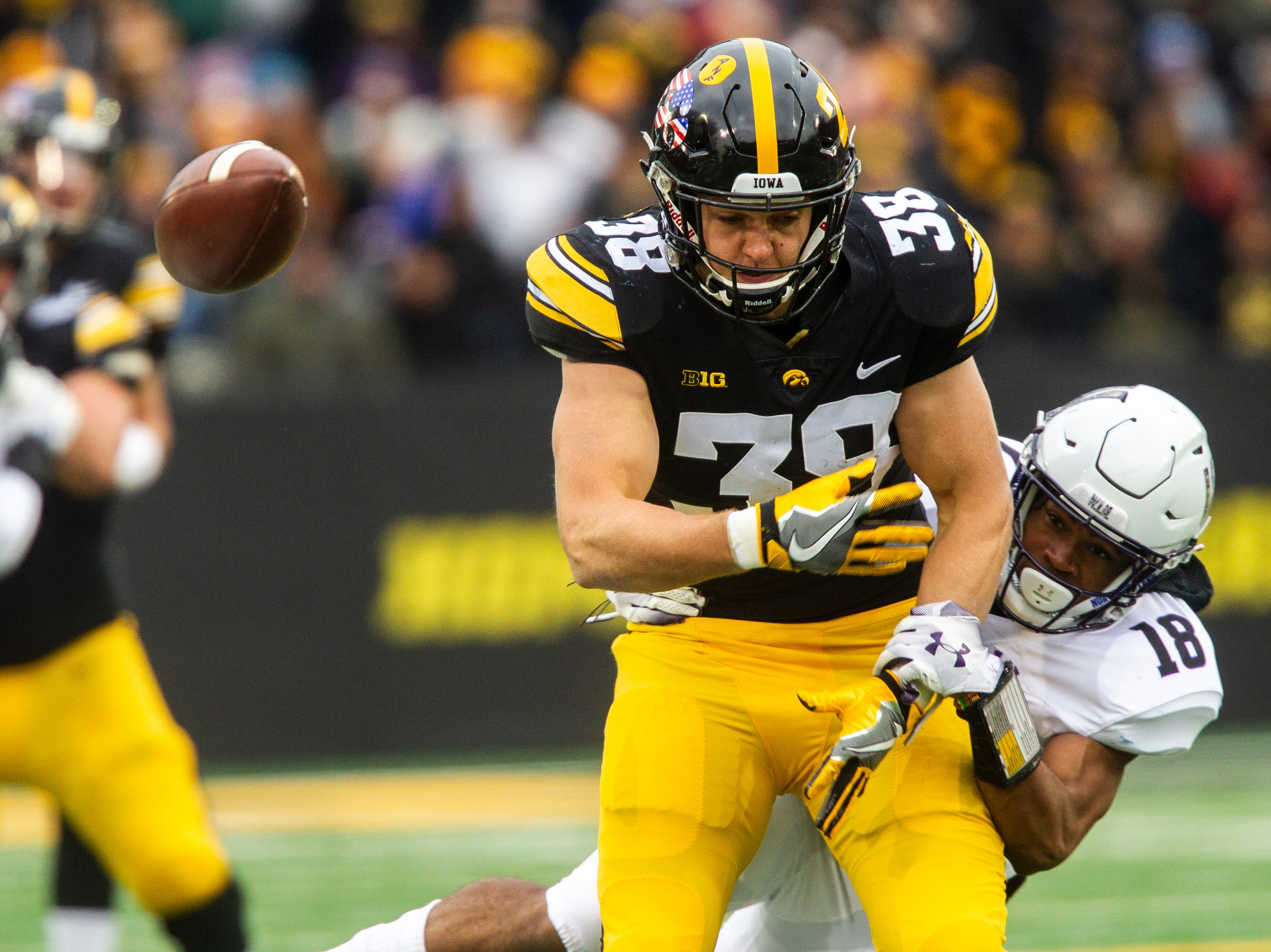 Iowa tight end T.J. Hockenson (38) can't come up with a reception while being covered by Northwestern's Cameron Ruiz (18) during a Big Ten Conference football game on Saturday, Nov. 10, 2018, at Kinnick Stadium in Iowa City.