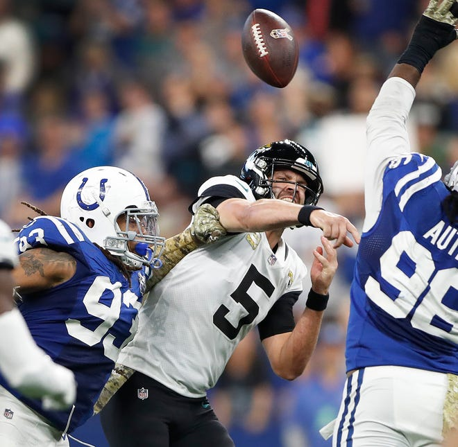 Indianapolis Colts defensive end Jabaal Sheard (93) pressures Jacksonville Jaguars quarterback Blake Bortles (5) in the second half of their game at Lucas Oil Stadium on Sunday, Nov. 11, 2018. The Colts defeated the Jaguars 29-26.