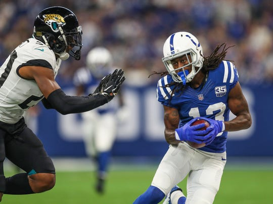 Indianapolis Colts wide receiver T.Y. Hilton (13) gets a first down after a catch against the Jacksonville Jaguars at Lucas Oil Stadium on Sunday, Nov. 11, 2018.