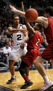 Butler Guard Aaron Thompson passes the ball around Miami of Ohio Guard Mekhi Lairy at the baseline during the first half of the game at Hinkle Fieldhouse on Saturday, November 10, 2018. Matt Detrich/For The Star