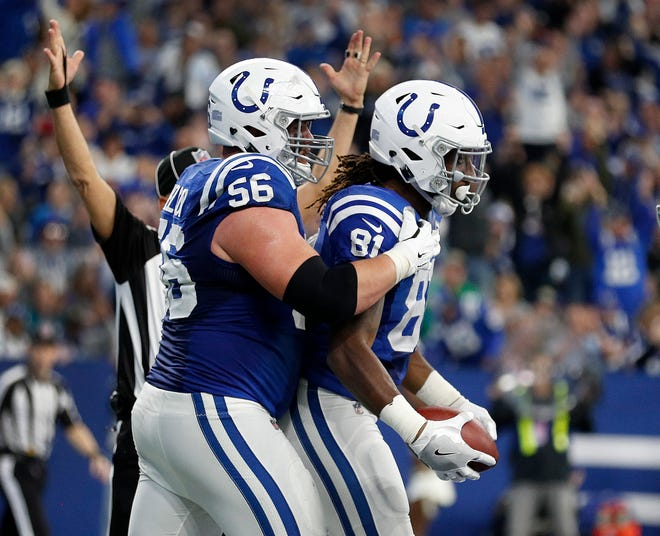 Indianapolis Colts tight end Mo Alie-Cox (81) celebrates his touchdown with guard Quenton Nelson (56) in the first half of their game at Lucas Oil Stadium on Sunday, Nov. 11, 2018.