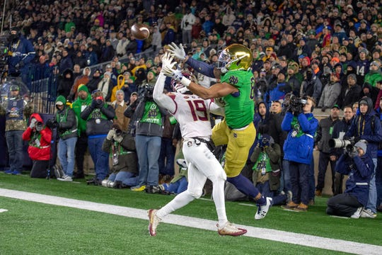 Notre Dame tight end Alize Mack (86) caught a pass for a touchdown as Florida State Seminoles defensive back A.J. Westbrook (19) defended in their game at Notre Dame Stadium. Mandatory Credit: Matt Cashore-USA TODAY Sports