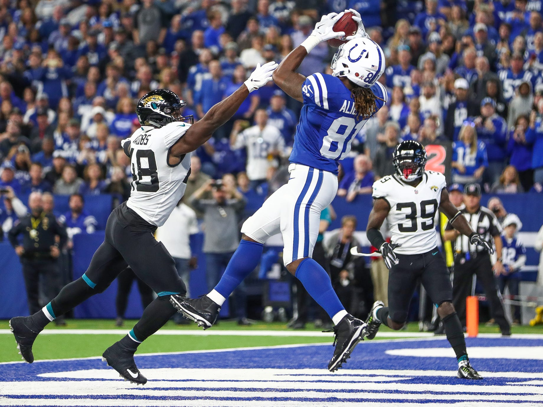 Indianapolis Colts tight end Mo Alie-Cox (81) pulls in a touchdown pass against the Jacksonville Jaguars at Lucas Oil Stadium on Sunday, Nov. 11, 2018.