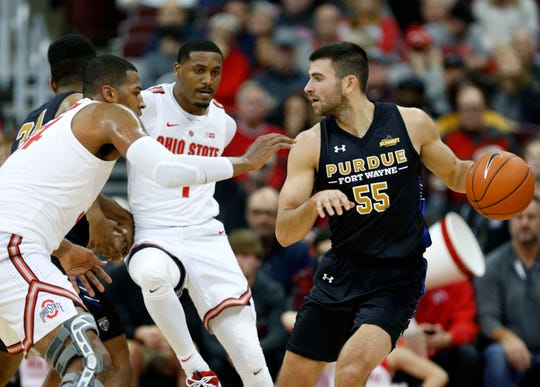 Purdue Fort Wayne guard John Konchar, right, drives against Ohio State forward Kaleb Wesson, left, and forward Luther Muhammad during the first half of an NCAA college basketball game in Columbus, Ohio, Sunday, Nov. 11, 2018.